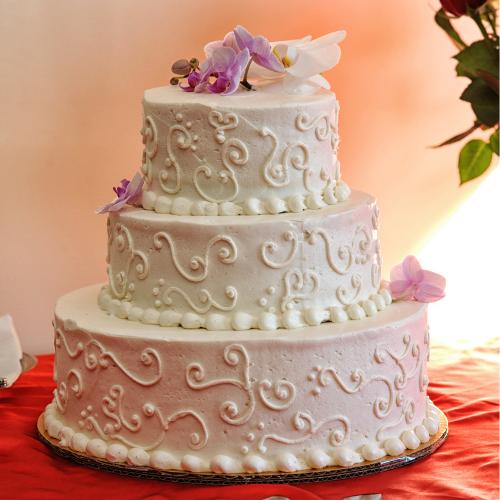 knife cutting wedding cake