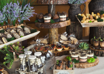 desserts on muli tiered shelving at a wedding