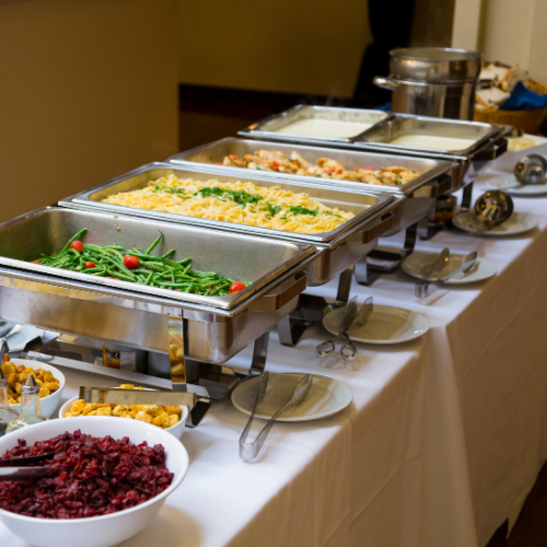 buffet server with food in them all in a  row