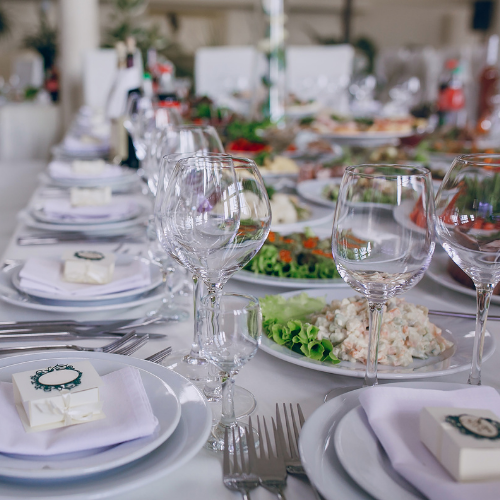 table settings at a wedding for dinner on a white tablecloth