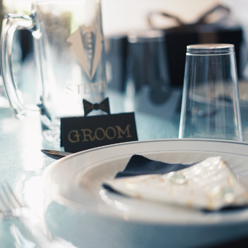 groom place setting at a wedding table with groom sign