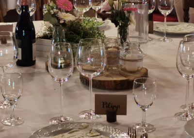 wedding table set with wine carafe and plates