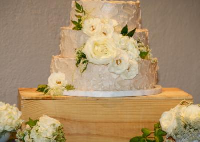white wedding cake with white roses 3 tier