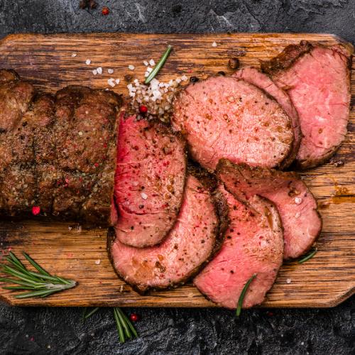 roast beef cut on a wood cutting board