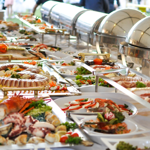 buffet table with tons of food on it
