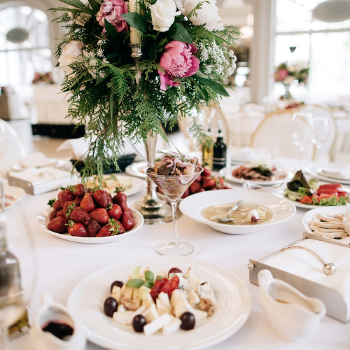 table with flowers and food at a wedding