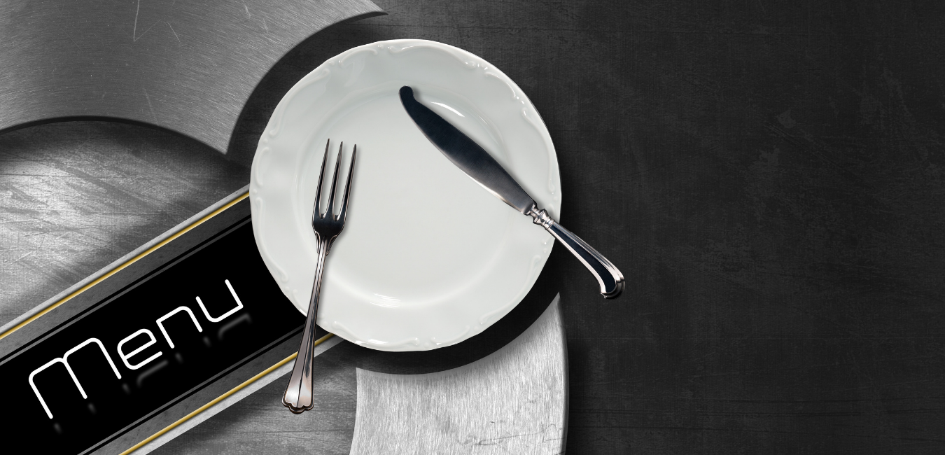 the word menu on a silver plate with a white plat and silverware