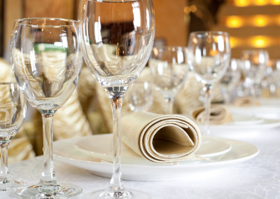 wine glasses ona table white tablecloth